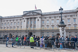 © Licensed to London News Pictures. 02/05/2015. London, UK. The queue to see the royal birth announcement of the Duke and Duchess of Cambridge's second child, a daughter, born at 8.34am, today, 2 May 2015, is posted on an easel outside Buckingham Palace.  The document is signed by the the delivery team at St Mary's Hospital in Paddington - led by Alan Farthing, the royal surgeon-gynaecologist . Photo credit : Stephen Chung/LNP