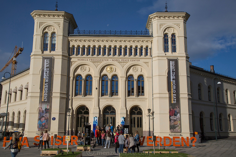 Nobel Peace Center in Oslo, Norway, with large Hungry Planet: What the World Eats exhibit open September 2013  to February 2014.