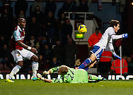 Picture by David Horn/Focus Images Ltd +44 7545 970036<br /> 23/11/2013<br /> Jussi Jaaskelainen of West Ham United fouls Oscar of Chelsea for a penalty during the Barclays Premier League match at the Boleyn Ground, London.