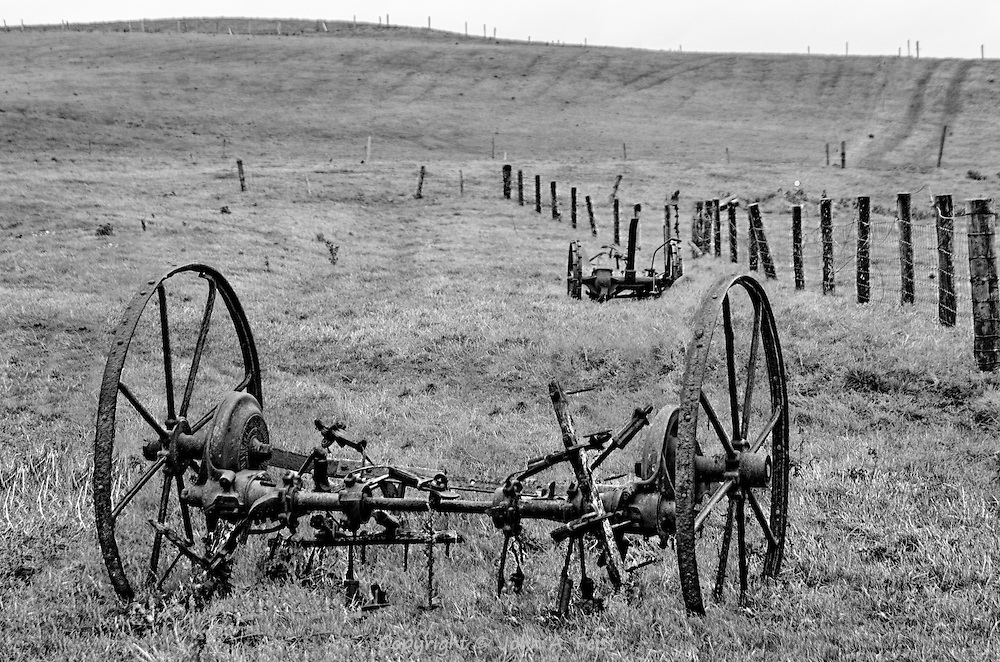 Atop the Cliffs Of Moher in County Clare, Ireland is a farm!  What amazed me was that this field is within 100 feet of the edge ofthe cliffs!  I have no idea how old this equipment is or whether it is still used.  I love how the black and white treatment creates a timeless feel for this image.