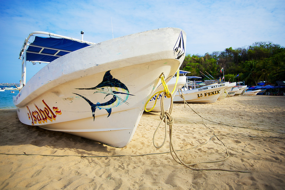 Fishing boats lined up on Playa Angelito in Puerto Escondido, México