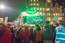 Westminster, London, December 2nd 2015.  As Parliament prepares to vote on air strikes on Islamic State terrorists in Syria, Stop The War and other groups opposed to British military involvement protest outside Parliament.  ///FOR LICENCING CONTACT: paul@pauldaveycreative.co.uk TEL:+44 (0) 7966 016 296 or +44 (0) 20 8969 6875. ©2015 Paul R Davey. All rights reserved.
