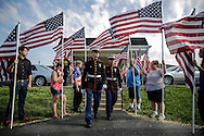U.S. Marines during the funeral of U.S. Marine Lance Corporal Steven Hancock at the First Christian Church in Morrison Friday, May 30, 2014. Hancock died after falling from a MV-22B Osprey during a training exercise in North Carolina on May 19.