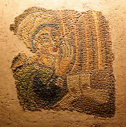 Part of a mosaic with a depiction of a woman donor at the feet of crucified Christ.  probably from Italy, late 7th-early 8th century.