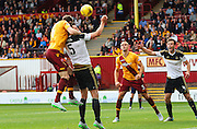 Stephen McManus beats Ash Taylor to the header during the Ladbrokes Scottish Premiership match between Motherwell and Aberdeen at Fir Park, Motherwell, Scotland on 15 August 2015. Photo by Craig McAllister.
