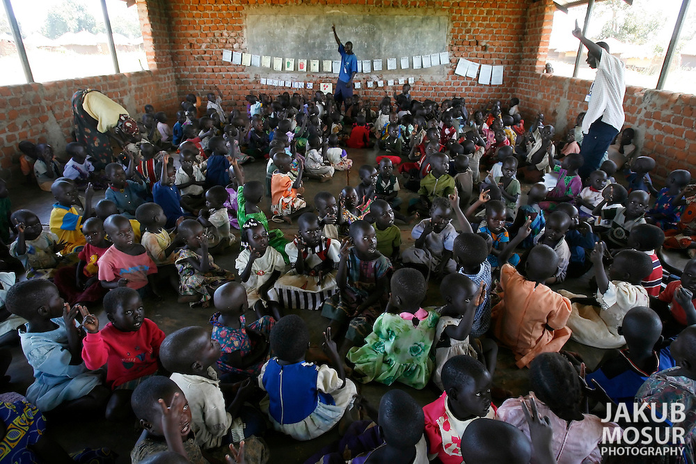 October 6, 2006 - Children sit in class at a day care center in Coope camp for internally displaced people, or IDP, near Gulu in north Uganda. Coope, with a population of 18,000, is one of 76 IDP camps around Gulu, the main base for the Uganda Peoples Defense Force fighting the insurgent Joseph Kony's Lord's Resistance Army. Kony's LRA movement has been fighting for the past 20 years to force the East African country to be ruled according to the Christian Ten Commandments. Over 2 million people, mostly of the Acholi tribe, have moved or were forced to move from their villages to camps close to the towns of Gulu, Lira, and Kitgum where they are watched over by the Ugandan Army. The LRA rebels have abducted thousands of children and have forced them to fight against the Ugandan Army and the Acholi people. Current peace talks between Kony's LRA and the Ugandan government held in Juba, southern Sudan, offer a glimpse of hope to ending this ongoing conflict..(Photo by Jakub Mosur/Polaris)<br />