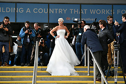 © Licensed to London News Pictures. 02/10/2017. Manchester, UK. KATIE HOPKINS seen wearing a wedding dress at the second day of the Conservative Party Conference. The four day event is expected to focus heavily on Brexit, with the British prime minister hoping to dampen rumours of a leadership challenge. Photo credit: Ben Cawthra/LNP