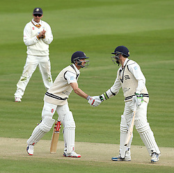 Middlesex's Josh Simpson shakes the hand of Middlesex's Tim Murtagh after bringing up his fifty - Photo mandatory by-line: Robbie Stephenson/JMP - Mobile: 07966 386802 - 03/05/2015 - SPORT - Football - London - Lords  - Middlesex CCC v Durham CCC - County Championship Division One