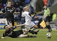 Photo: Aidan Ellis.<br /> Bolton Wanderers v Sunderland. The Barclays Premiership. 18/03/2006.<br /> Sunderland's Gary breen brings down Bolton's Stellios