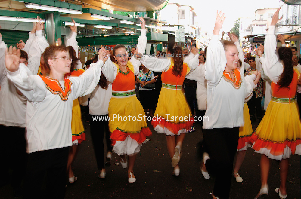 Israel, Tel Aviv A group of Israeli folk dancers dancing in the Hatikva market place