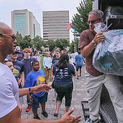 Former New York Yankees All-Star pitcher Mariano Rivera (LEFT) helps volunteers unload a UPS truck full of backpack during a give-away sponsored by &quot;The Mariano Rivera Public Foundation&quot; Monday, August. 14, 2017, at Rodney Square in Wilmington Delaware. <br /> <br /> More than 1,500 backpacks filled with back-to-school supplies was given to children in grades K through 5th grade.