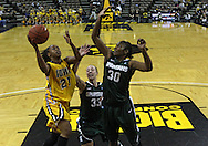 January 27 2010: Iowa guard Kachine Alexander (21) puts up a shot as Michigan St. forward Taylor Alton (33) and Michigan St. forward Lykendra Johnson (30) defend during the second half of an NCAA women's college basketball game at Carver-Hawkeye Arena in Iowa City, Iowa on January 27, 2010. Iowa defeated Michigan State 66-64.