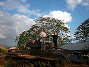 Vietnam, Dien Bien Phu :  souvenir photos taken by a tank left from the indipendance  battle against the French army in 1954 spots seem to be memorials to wartime propaganda as much to the war itself. in their new struggle for foreign currency, the Vietnamese are exploiting their harsh history, offering visits to long-forgotten places that were once considered vital to America's national interests. Most of the visitors here are foreigners; the Vietnamese who come are mostly schoolchildren with their teachers.