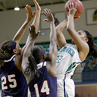UNCW's Amber Reeves shoots over Florida Atlantic's Chenise Miller, left, and Latavia Dempsey. (Jason A. Frizzelle)
