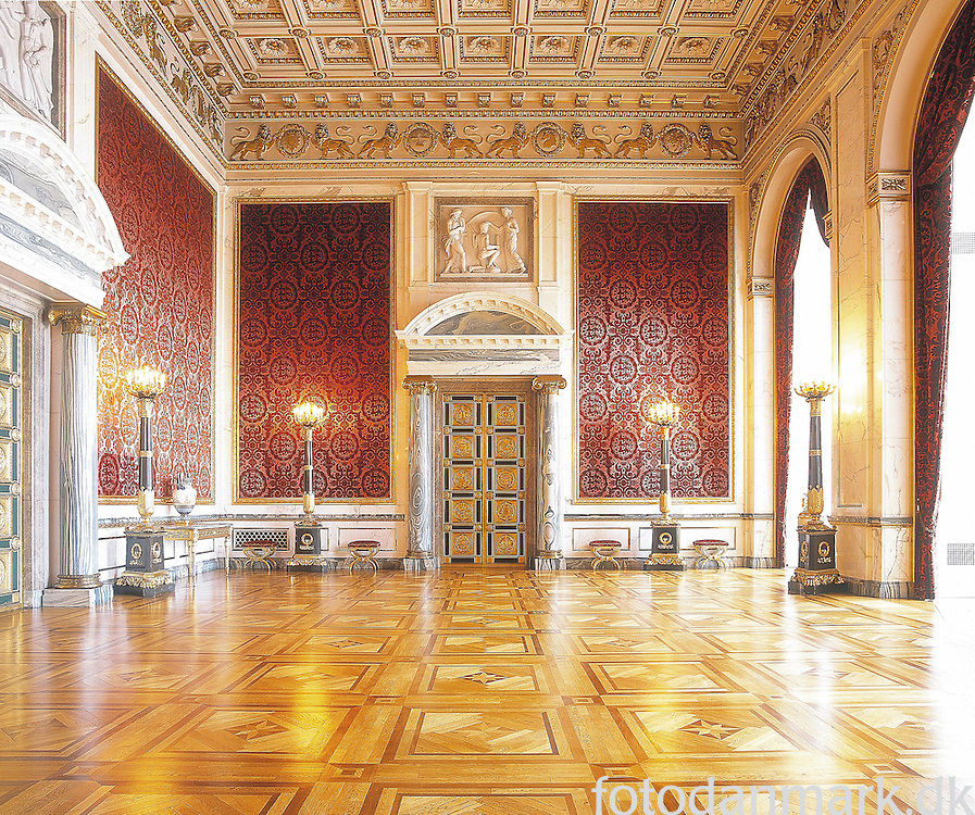 Christiansborg Palace in Copenhagen is not a recidential palace for the royal danish family, but used for ceremony. The danish parlament are even located in the same building. The palace was build in 1928, and the name of the arcitect is Thorvald Jørgensen. Christiansborg Palace (Danish: Christiansborg Slot; pronounced [krɪsdjænsˈbɔːɐ̯ˀ]), on the islet of Slotsholmen in central Copenhagen, is the seat of the Danish Parliament, the Danish Prime Minister's Office and the Danish Supreme Court. Also, several parts of the palace are used by the monarchy, including the Royal Reception Rooms, the Palace Chapel and the Royal Stables.