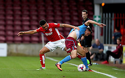 Derrick Williams of Bristol City tackles Tom Hopper of Scunthorpe United - Mandatory by-line: Robbie Stephenson/JMP - 23/08/2016 - FOOTBALL - Glanford Park - Scunthorpe, England - Scunthorpe United v Bristol City - EFL Cup second round