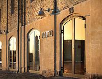 The exterior of Noma Restaurant in Copenhagen at sunset.