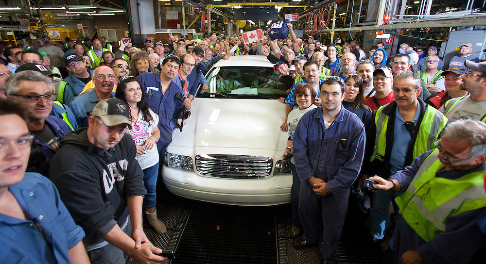 St.Thomas, Ontario ---11-09-15--- Employees gather around as the last Ford Crown Victoria rolls off the production at the St. Thomas Assembly Plant in St. Thomas, Ontario, September 15, 2011. <br /> CNW/ Ford Handout/ GEOFF ROBINS