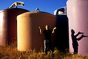 """Richard Heinichen, owner of Rainwater Bottled Water Company, looks to the skies to fill his massive tank farm--dubbed """"Tank Town."""" In the Hill Country west of Austin, well-water is calcium laden, pants-stiffening and virtually undrinkable."""