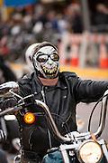 A biker wearing a skull mask cruises down Main Street during the 74th Annual Daytona Bike Week March 7, 2015 in Daytona Beach, Florida.