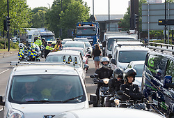 © Licensed to London News Pictures. 17/07/2019; Bristol, UK. Extinction Rebellion Summer Uprising 2019. Traffic backs up as Extinction Rebellion block a major road junction at morning rush hour on Newfoundland Road coming into Bristol city centre causing traffic delays up the M32 to the M4 motorway. Campaigners locked themselves onto a pink bath tub, and held 7 minute roadblocks on other parts of the junction complex. Extinction Rebellion are holding a five-day 'occupation' of Bristol, by occupying Bristol Bridge in the city centre and traffic has to be diverted and carrying out other events. As part of a country-wide rebellion called Summer Uprising, followers will be holding protests in five cities across the UK including Bristol on the theme of water and rising sea levels, which is the group's focus for the South West. The campaign wants the Government to change its recently-set target for zero carbon emissions from 2050 to 2025. Photo credit: Simon Chapman/LNP.