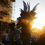 Carnival crowd in Ridley Road in the dying sun. Hackney carnival 2016 took place on a hot Indian summer's day, September 2016 with the streets full of partying people.