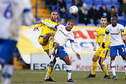 Terell Thomas of Wimbledon and Neil Danns of Tranmere Rovers contest a loose ball  during the EFL Sky Bet League 1 match between Tranmere Rovers and AFC Wimbledon at Prenton Park, Birkenhead, England on 21 December 2019.