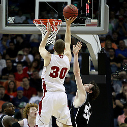 Mar 24, 2011; New Orleans, LA; Wisconsin Badgers forward Jon Leuer (30) shoots over Butler Bulldogs forward Matt Howard (54)  during the first half of the semifinals of the southeast regional of the 2011 NCAA men's basketball tournament at New Orleans Arena.  Mandatory Credit: Derick E. Hingle