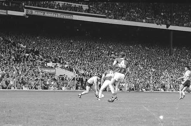 Dublin player picks the ball from the ground during the All Ireland Senior Gaelic Football Championship Final Kerry v Dublin at Croke Park on the 22nd September 1985. Kerry 2-12 Dublin 2-08.