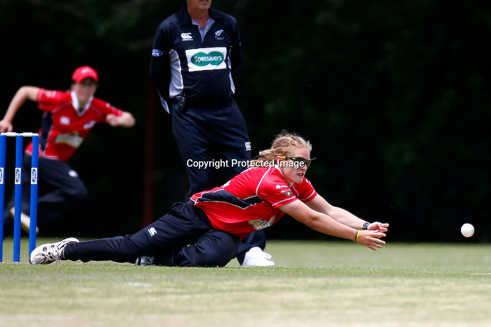Canterbury's Frances Mackay dives for the ball during the Action Cricket Cup match between the Auckland Hearts vs Canterbury Magicians. Women's domestic one day cricket. Melville Park, Auckland, New Zealand. Saturday 4 December 2011. Ella Brockelsby / photosport.co.nz