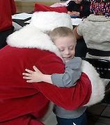 gbs120416d/ASEC -- Brody Willett, 6, of Albuquerque gets a hug from Santa Claus, aka Dennis Curtis of Rio Rancho, during the Sensitive Santa event at Cottonwood Mall on Sunday morning, Dec. 4, 2016. The RSVP event before regular mall hours provided children with special needs and their families with a sensory friendly environment to safely experience the tradition of visiting Santa Claus. (Greg Sorber/Albuquerque Journal)