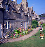 Almshouses and garden in the village of Marshfield, Wiltshire, England