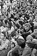 Genova, venerdì 20 luglio 2001. Giornata delle piazze tematiche.  Dopo il corteo della disobbedienza civile, allo stadio Carlini un manifestante piange durante l'assemblea.