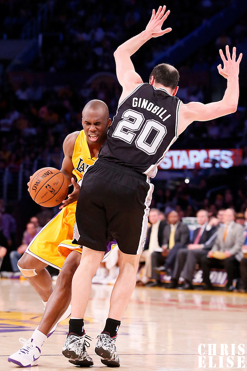 19 March 2014: Los Angeles Lakers guard Jodie Meeks (20) is fouled by San Antonio Spurs guard Manu Ginobili (20) during the San Antonio Spurs 125-109 victory over the Los Angeles Lakers at the Staples Center, Los Angeles, California, USA.