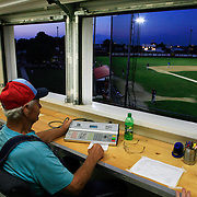Longtime Clarinda A's scorekeeper Edwin Ratashak, 86, has a birds -eye view of the field as he performs his important task.  photo by David Peterson