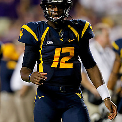 Sep 25, 2010; Baton Rouge, LA, USA; West Virginia Mountaineers quarterback Geno Smith (12) during warms ups before kickoff of a game against the LSU Tigers at Tiger Stadium.  Mandatory Credit: Derick E. Hingle