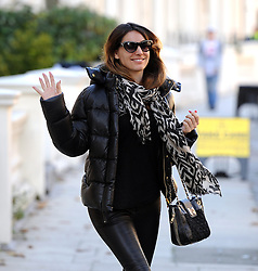 Model Kelly Brook dressed all in black, puffer jacket, leather trousers and trainer boots, left her home and headed into central London for a bite to eat. UK. 14/11/2012<br />