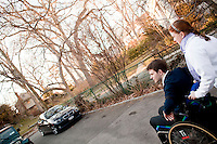 29 December, 2009. Bronxville, NY. Francesco Clark, 30, founder and president of Clark's Botanicals, is accompanied by his assistant Kathryn Whitney, 18, from the garage where he exercises to his home office. Francesco Clark suffers a crippling cord injury due to a swimming pool diving accident on June 1, 2002. Clark's Botanicals was born out of the tragedy.<br /> With his central nervous system impaired, Francesco, who was then an assistant stylist at Harper's Bazar, lost the ability not only to walk, but even to sweat. This led to clogged pores and chronic breakouts. When neither over-the-counter nor prescriptive remedies worked, he turned to his father, Dr. Harold Clark, a physician trained in both traditional Western medicine and homeopathy.<br /> <br /> Together they developed botanically-based formulas that effectively rebalanced Francesco's skin, clearing it up entirely. Through word-of-mouth, other people discovered and fell in love with these products, and in 2005, Francesco began selling Clark's Botanicals on his website.<br /> ©2009 Gianni Cipriano for The New York Times<br /> cell. +1 646 465 2168 (USA)<br /> cell. +1 328 567 7923 (Italy)<br /> gianni@giannicipriano.com<br /> www.giannicipriano.com