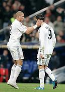 Real Madrid's Pepe comforts Cristiano Ronaldo during La Liga match, November 05, 2009.