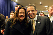 Albertson, New York, U.S. 26th October 2013. New York Governor ANDREW CUOMO, at right, poses for a photo after he endorses TOM SUOZZI for Nassau County Executive, at the Albertson Veterans of Foreign Wars VFW Post. Democrat Suozzi, the former Nassau County Executive, and Republican incumbent Mangano face each other in a rematch in the upcoming November 5th election.