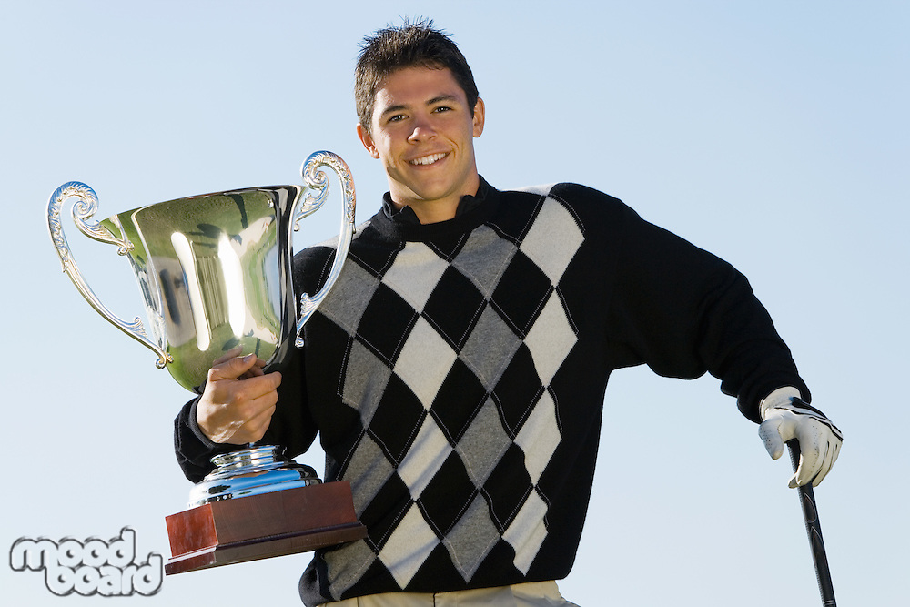 Golf Tournament Champion Holding Trophy