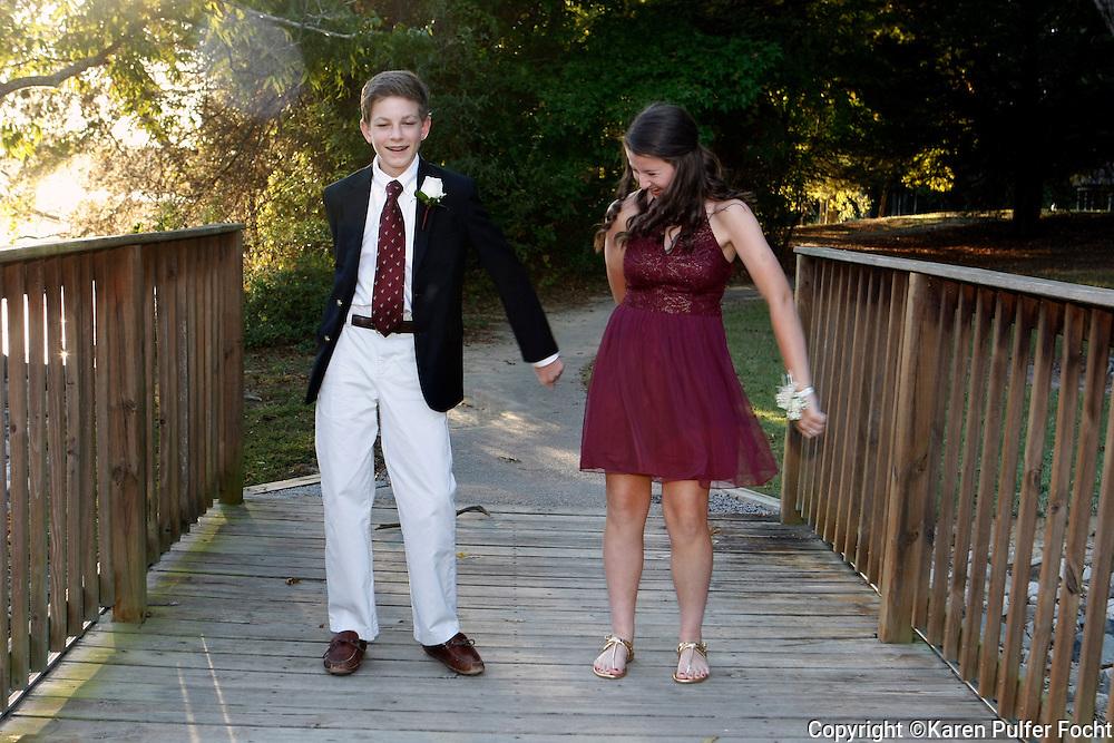 Teens practice dancing before their homecoming date.