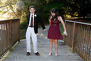 Teens practice dancing before their homecoming date.