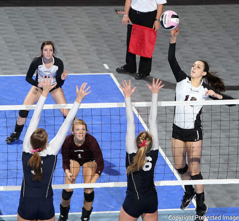 Mount Vernon's Amanda Platte (18) goes up for a kill over Sioux City Bishop Heelan's Natalie Vondrak (5) and Leisa McClintock (6) during the fourth game of a 3A semifinal in the state volleyball tournament at the U.S. Cellular Center at 370 1st Ave E on Friday afternoon, November 12, 2010. (Stephen Mally/Freelance)
