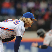NEW YORK, NEW YORK - MAY 01: Pitcher Noah Syndergaard #34 of the New York Mets fails to hold the runner on first as Matt Duffy #5 of the San Francisco Giants steals second during the New York Mets Vs San Francisco Giants MLB regular season game at Citi Field on May 01, 2016 in New York City. (Photo by Tim Clayton/Corbis via Getty Images)