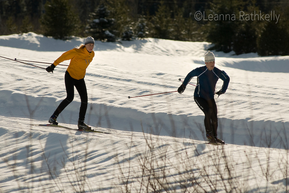Cross country skiers Maria Lundgren and Munro Duncan skate the trails at Green Lake, part of the Lost Lake trail system in Whistler, BC