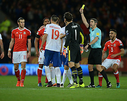 Vladimir Stojkovic of Serbia is shown a yellow card. - Mandatory by-line: Alex James/JMP - 12/11/2016 - FOOTBALL - Cardiff City Stadium - Cardiff, United Kingdom - Wales v Serbia - FIFA European World Cup Qualifiers