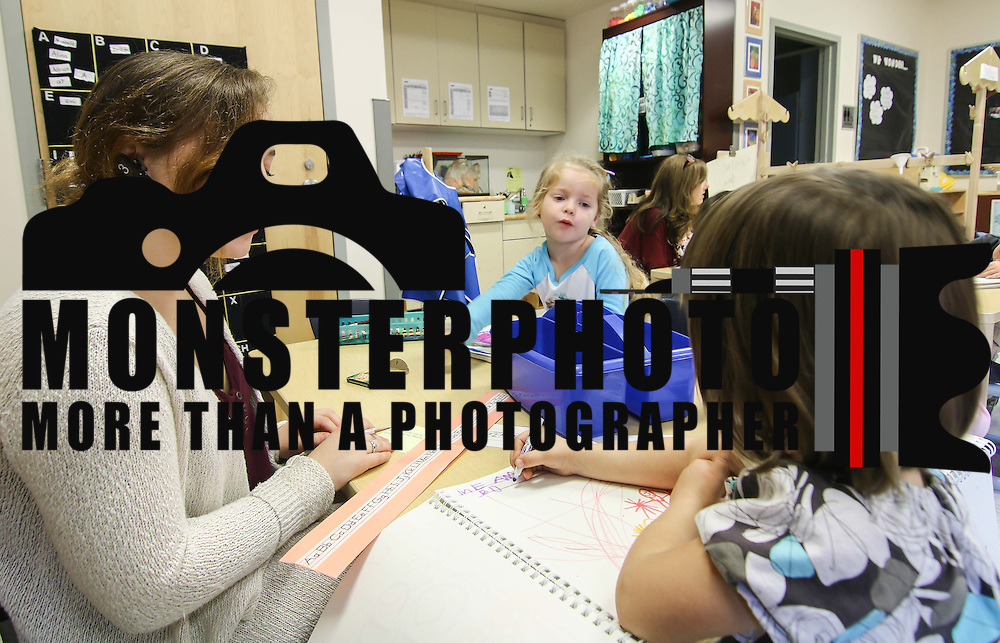Student teacher Charlotte Christie, LEFT, wears a wireless headset to communicate with Master Teacher while teaching a class Thursday, Nov. 05, 2015 at UD Laboratory Preschool in Newark.