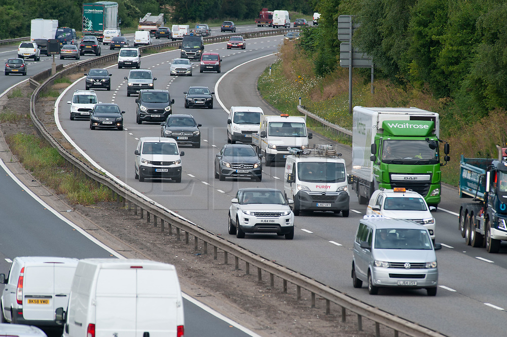 ©Licensed to London News Pictures 13/07/2020     <br /> Swanley, UK. Early morning commuter traffic on the M25 in Kent between junctions three and four. People get back to work using the car as more and more of the workforce come out of coronavirus lockdown this morning. Photo credit: Grant Falvey/LNP