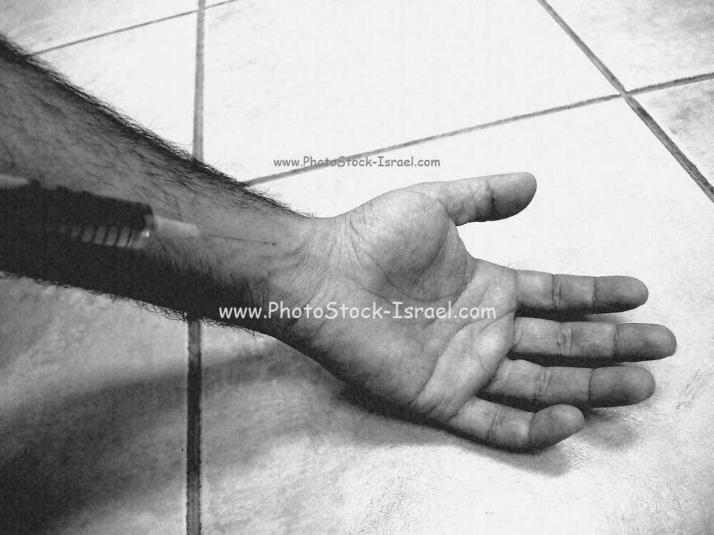 Drug abuse concept needle and arm